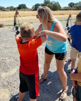 Paige Pearce teaches children her love of archery.